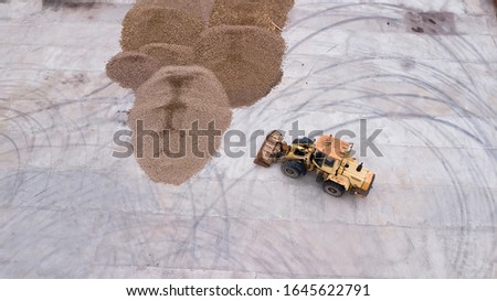 the loader loads the potatoes, top view #1645622791