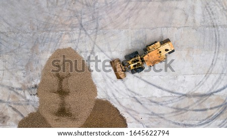 the loader loads the potatoes, top view #1645622794