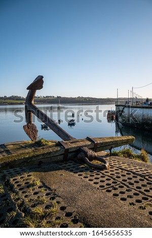 Large anchor in Appledore, North Devon, UK. Seafront, blue sky, looking out from the bay on a very sunny day.  Royalty-Free Stock Photo #1645656535