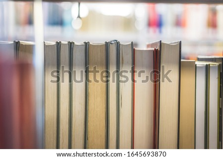 Close up picture of a variety of books in the public library.