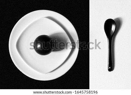 White dishes on a black background and black dishes on a white background #1645758196