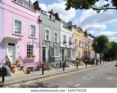 Colourful old terraced houses without parked cars, in London street. #164576318