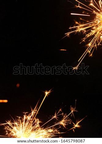 A burning sparkler/fireworks background design or creative template.  #1645798087