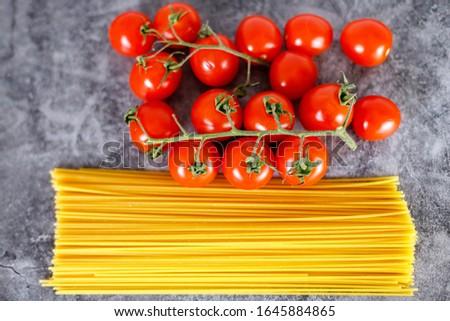 Italian spaghetti, tomatoes cherry and garlic, ingredients for pasta #1645884865