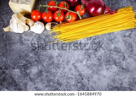 Italian spaghetti, tomatoes cherry and garlic, ingredients for pasta #1645884970