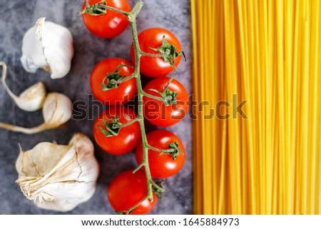 Italian spaghetti, tomatoes cherry and garlic, ingredients for pasta #1645884973