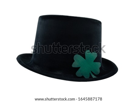 black bowler hat with green clover luck symbol on an isolated background #1645887178