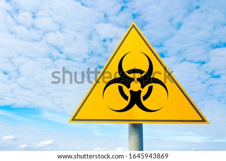 Bio hazard point of attention against the sky. yellow triangular sign. Danger warning. Attention