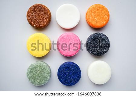 Colorful round solid shampoo bars (zero waste) Royalty-Free Stock Photo #1646007838