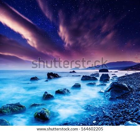 Majestic summer sunset over the sea. Dramatic overcast sky with colorful cloud. Crimea, Ukraine, Europe. Beauty world. #164602205