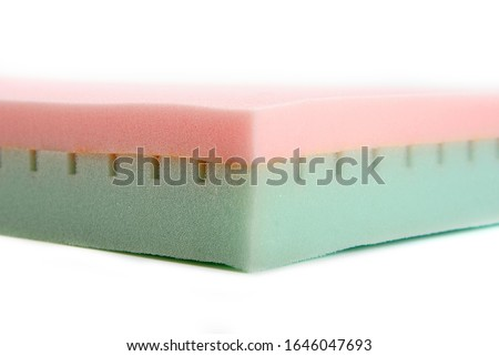 Close-up of green-pink comfortable medical foam sleeping mattress on white background #1646047693