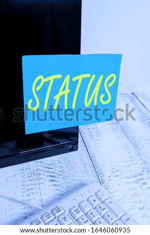 Handwriting text writing Status. Concept meaning situation at a particular time during a process Professional position Notation paper taped to black computer monitor screen near white keyboard. #1646060935