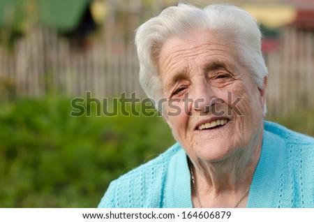 Portrait of a smiling elderly woman  #164606879