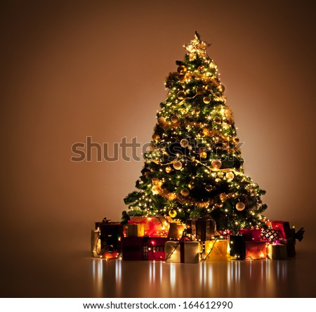 Beautifully decorated Christmas tree with many presents under it. #164612990