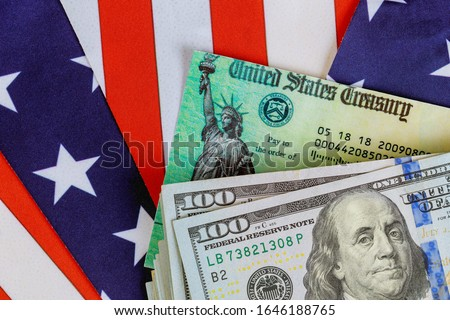 USA dollar cash banknote stimulus economic tax return check with US flag Royalty-Free Stock Photo #1646188765