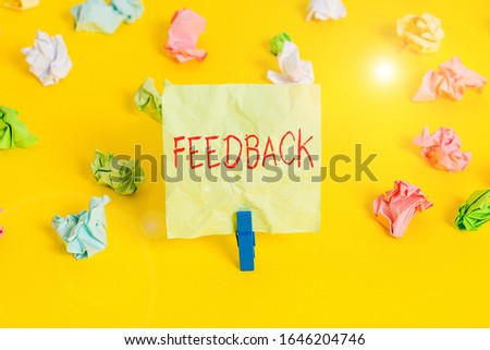 Writing note showing Feedback. Business photo showcasing information about reactions to product demonstratings perforanalysisce of task Colored crumpled paper empty reminder white floor clothespin. #1646204746