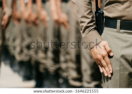 Asian police Line up Wearing a brown police uniform, asian police in uniform Do the duty Secure In the capital