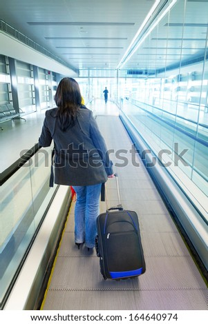 Woman traveling with luggage #164640974