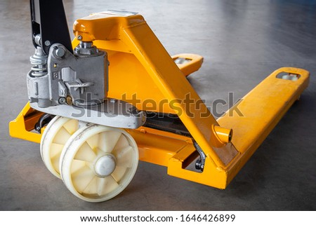 Yellow hand pallet truck, hand lift, pallet jack. Tools for loading and unloading goods #1646426899