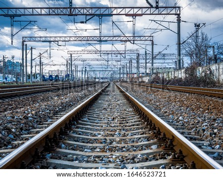 Picture of a railway with blue cloudy sky above.