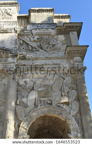 Detail of the front reliefs of the Triumphal Arch of Orange (Arc de triomphe d'Orange), Occitanie, France. It was built during the reign of Augustus on Via Agrippa #1646553523