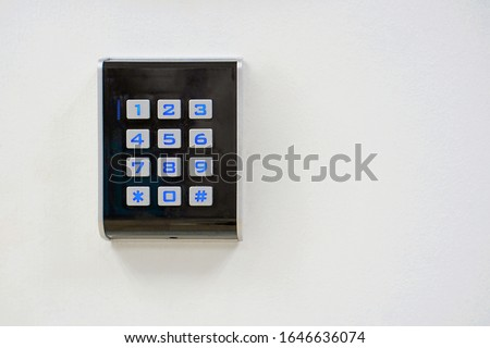 Secure password on keyboard for opening home house door. Password code Security keypad system protected in public building. Security code combination to unlock the door.                             Royalty-Free Stock Photo #1646636074