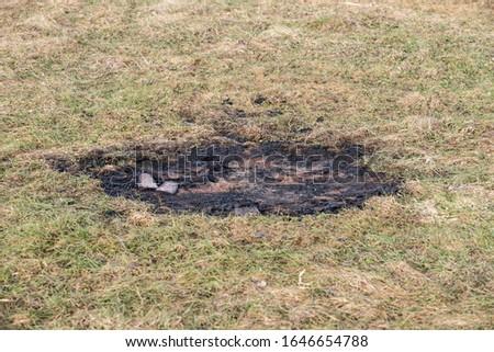 an extinct fire, a fire place, a burned-out place, a burned-out grass, a fire place,  #1646654788