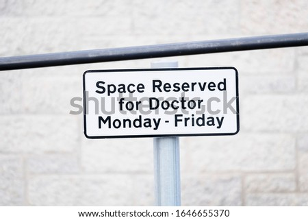 Doctor reserved car park space at hospital clinic sign