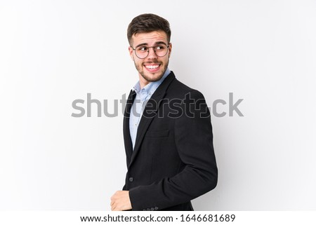 Young caucasian business man posing in a white background isolated Young caucasian business man looks aside smiling, cheerful and pleasant. #1646681689