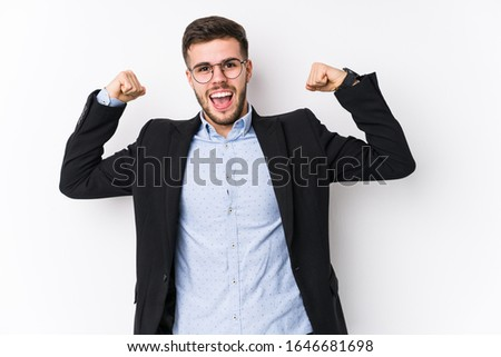 Young caucasian business man posing in a white background isolated Young caucasian business man showing strength gesture with arms, symbol of feminine power #1646681698