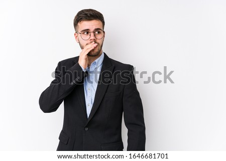 Young caucasian business man posing in a white background isolated Young caucasian business man thoughtful looking to a copy space covering mouth with hand. #1646681701