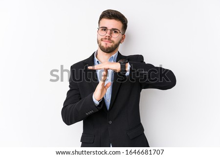 Young caucasian business man posing in a white background isolated Young caucasian business man showing a timeout gesture. #1646681707