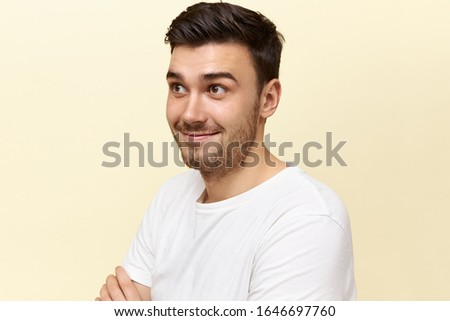 Human facial expressions, emotions and feelings. Emotional attractive young male raising his eyebrows surprised with astonishing news. Cute guy having impressed shocked look, expressing disbelief #1646697760