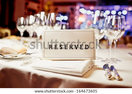 Reserved sign on a table in restaurant Royalty-Free Stock Photo #164673605