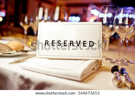 Reserved sign on a table in restaurant Royalty-Free Stock Photo #164673653