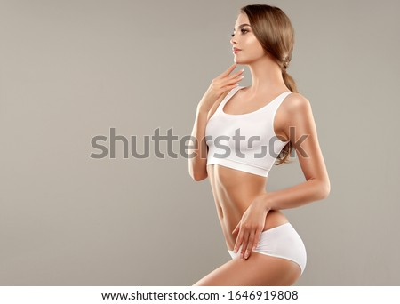 Perfect slim toned young body of the girl . An example of sports , fitness or plastic surgery and aesthetic cosmetology. Royalty-Free Stock Photo #1646919808