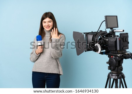 Young reporter woman holding a microphone and reporting news inviting to come #1646934130