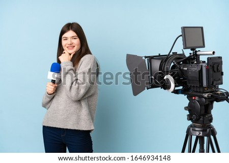 Young reporter woman holding a microphone and reporting news laughing #1646934148