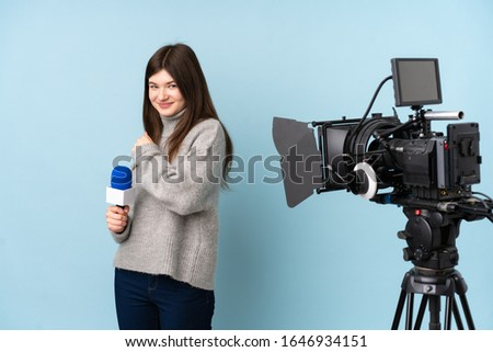 Young reporter woman holding a microphone and reporting news celebrating a victory #1646934151