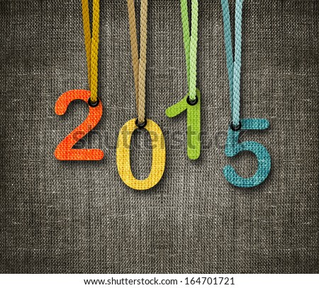 Happy New year 2015,  numbers hunging by rope as puppeteer on sackcloth background, the same concept available for 2016. Royalty-Free Stock Photo #164701721