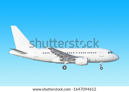 white airplane side view isolated on blue sky background. Passenger jet plane with gear extended. Commercial aircraft paint scheme. Luxury business jet flying in air. Aviation design reference photo