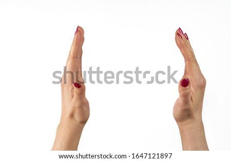 adult female hands measuring something, isolated on white. Royalty-Free Stock Photo #1647121897