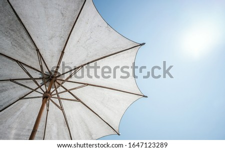 Parasol umbrella under the sky on day light afternoon time. Royalty-Free Stock Photo #1647123289