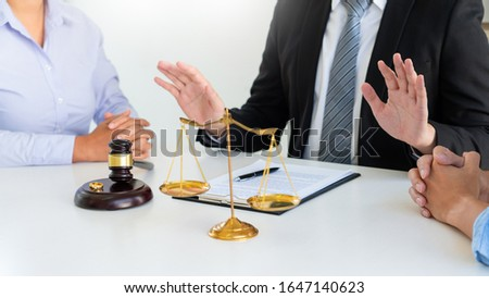 Judge gavel deciding on agreement prepared marriage divorce and Angry couple arguing telling their problems settlement, legal separation concept  Royalty-Free Stock Photo #1647140623