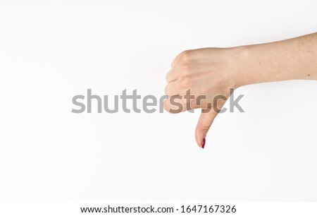 Hand thumb down isolated on the left side on white background. Rejection symbol Royalty-Free Stock Photo #1647167326