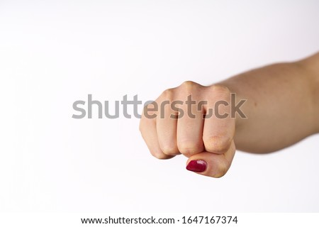 Woman fist isolated on white background.