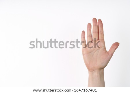 Female hand extended in greeting isolated on white. Number five. Royalty-Free Stock Photo #1647167401