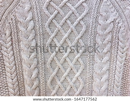 Knitted background. Knitted texture. Knitting pattern of wool. Knitting. Texture of knitted woolen fabric for wallpaper and an abstract background    #1647177562