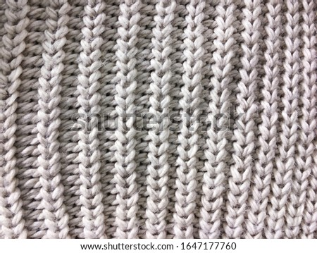 Knitted background. Knitted texture. Knitting pattern of wool. Knitting. Texture of knitted woolen fabric for wallpaper and an abstract background    #1647177760