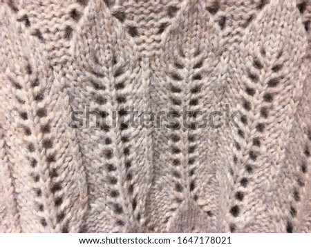 Knitted background. Knitted texture. Knitting pattern of wool. Knitting. Texture of knitted woolen fabric for wallpaper and an abstract background    #1647178021